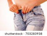 weight gain woman getting...   Shutterstock . vector #703283938