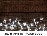 christmas lights glowing on... | Shutterstock . vector #703291933
