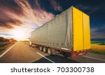 truck on the road driving along ... | Shutterstock . vector #703300738