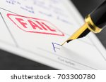 red seal fail stamped on a form ... | Shutterstock . vector #703300780