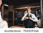 client is elegant guy trying on ...   Shutterstock . vector #703329166