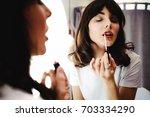 portrait of a beautiful woman ... | Shutterstock . vector #703334290