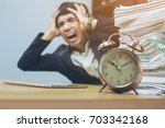 Small photo of The concept of stressed men working against time.selective focus,softfocus