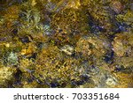 detail of river water with... | Shutterstock . vector #703351684