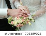 gold wedding rings on the hands ... | Shutterstock . vector #703359028