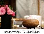aroma oil diffuser in bathroom | Shutterstock . vector #703363336