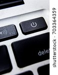 the power button on a keyboard... | Shutterstock . vector #703364359