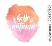 hello autumn ink lettering.... | Shutterstock . vector #703377904