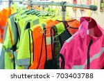 reflective vests for road safety | Shutterstock . vector #703403788