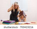 the teacher screams at the... | Shutterstock . vector #703423216
