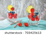 mason jars with delicious... | Shutterstock . vector #703425613