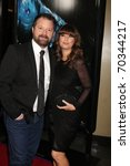 """Small photo of LOS ANGELES - JAN 31: Alister Grierson, wife Skve arrives at the """"Sanctum"""" Premiere at Mann's Chinese 6 Theaters on January 31, 2011 in Los Angeles, CA"""