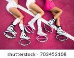 three sexy legs of girls laying ... | Shutterstock . vector #703453108