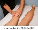 wellness foot and foot massage | Shutterstock . vector #703476280