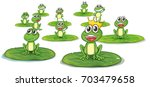 happy frogs on lotus leaves... | Shutterstock .eps vector #703479658