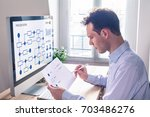 businessman or engineer working ... | Shutterstock . vector #703486276