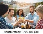 group of friends having... | Shutterstock . vector #703501138
