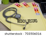 medical record folders and... | Shutterstock . vector #703506016
