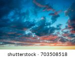 dramatic sunset with clouds of... | Shutterstock . vector #703508518