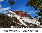 the potala palace in tibet of... | Shutterstock . vector #703550440