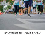 group of people exercising... | Shutterstock . vector #703557760