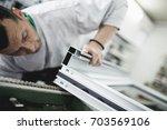 manual worker assembling pvc... | Shutterstock . vector #703569106