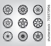set of car rims | Shutterstock .eps vector #703573906