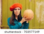 Funny Autumn Woman Holding...