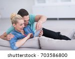 young couple relaxing at... | Shutterstock . vector #703586800