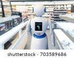 smart retail   robot assistant... | Shutterstock . vector #703589686