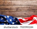 Small photo of American flag on a old wooden