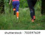 photo from back of sportswomen | Shutterstock . vector #703597639