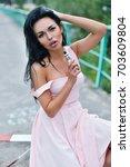 vaping. young beautiful woman... | Shutterstock . vector #703609804