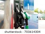 diesel and petrol pump | Shutterstock . vector #703614304