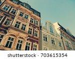 multicolored building facade in ... | Shutterstock . vector #703615354