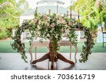 wedding flower arrangement  | Shutterstock . vector #703616719