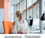 young female entrepreneur... | Shutterstock . vector #703618660