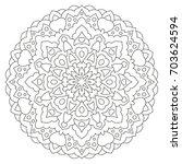 ethnic round mandala pattern on ...   Shutterstock .eps vector #703624594