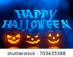 spooky pumpkin lanterns... | Shutterstock . vector #703635388