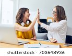 sharing happy moments. two... | Shutterstock . vector #703648936