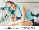 Positive Young Woman Wiping...