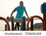 confident male athlete... | Shutterstock . vector #703656184