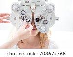young patient eye examination...   Shutterstock . vector #703675768