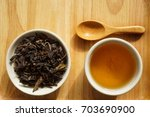 tea in a white cup on wooden... | Shutterstock . vector #703690900
