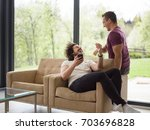 gay couple love home concept.... | Shutterstock . vector #703696828