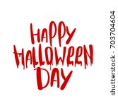 handwritten happy halloween... | Shutterstock .eps vector #703704604