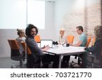 group of a young business... | Shutterstock . vector #703721770