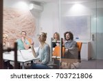 group of a young business... | Shutterstock . vector #703721806