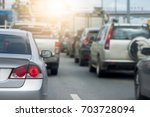 cars on the road heading... | Shutterstock . vector #703728094