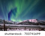 northern lights appear over... | Shutterstock . vector #703741699